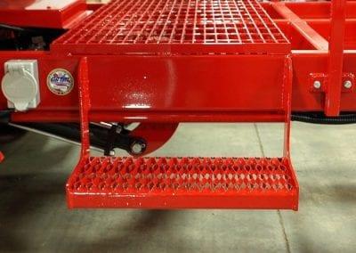 Hopper-step-on-Falcon-asphalt-reheater-and-hauler-700x524